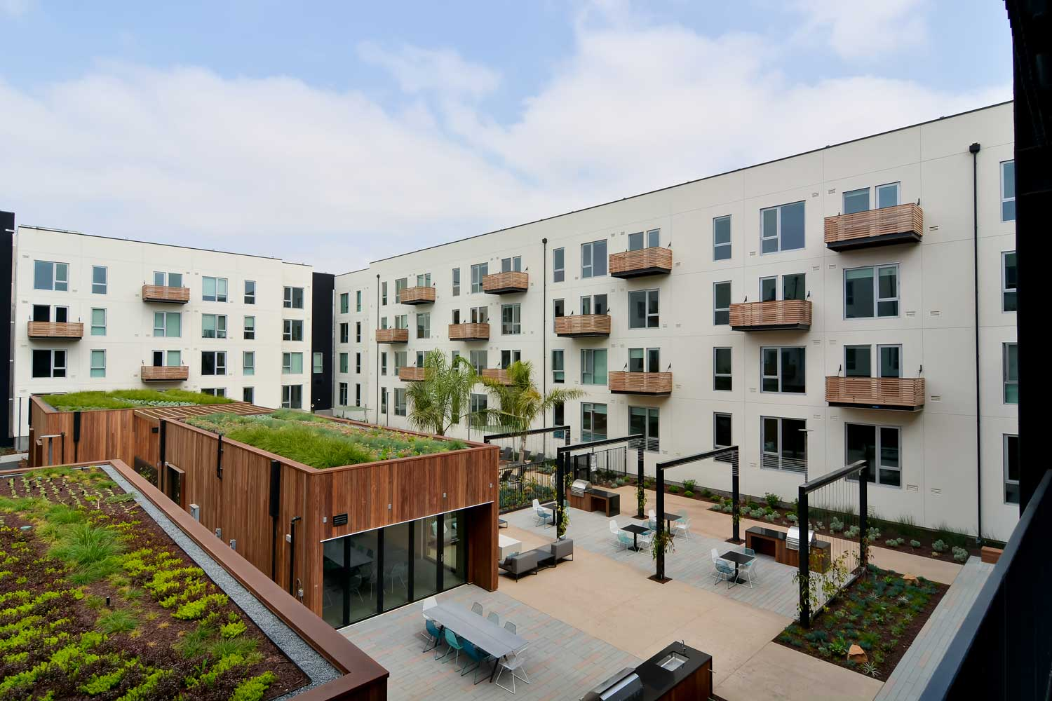 Union City California Apartments-The Union Flats Building Exterior with Lush Landscape and BBQ Grills