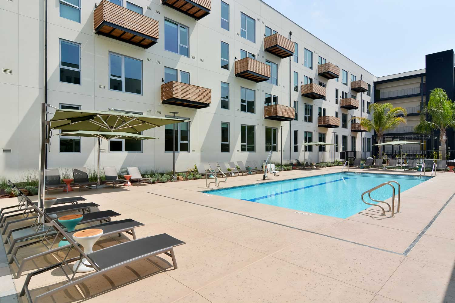 Luxury Apartments in Union City-The Union Flats Sparkling Pool with Lounge Chairs